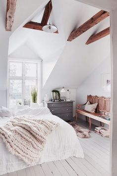 Bedroom decor ideas - White, neutral, romantic bohemian rustic style. Expose beamed ceiling, white bedding, grey dresser, painted wood floor.