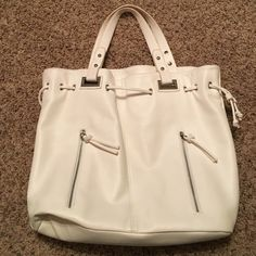 Used express tote Used for about 2 months, a few minor markings no holes/tears, inside has some discoloration but no tears, open to reasonable offers, no trades Express Bags Totes