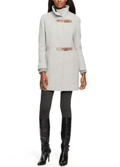Loving this polished fall ensemble that includes a chic equestrian-inspired coat and tall leather boots.