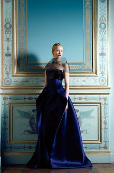 A princess-like Maud, alone in her castle, wanders aimlessly from room to room in search of something, wrapped only in lavish couture creations such as this sumptuous royal blue gown from the Armani Privé line. Editorial by Benjamin Kanarek for Harper's Bazaar     jaglady