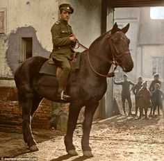 An unknown British Tommy from the 'A' Squadron, the North Irish Horse Regiment, with children watching