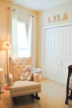 The Princessory!  A sophisticated baby girl's room.  Love the tufted rocker!
