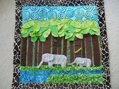 Interactive textured jungle baby quilt