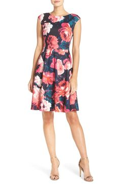 A classic cut and romantic flowers give this flattering Eliza J dress its wardrobe-staple appeal.