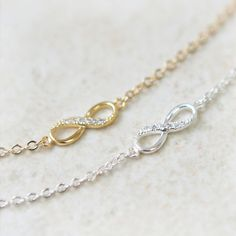 Infinity Bracelet /  Choose your color / gold and silver. $15.00, via Etsy.