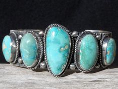 J'adore Native American jewelry, too. This features Persian turquoise and is made by Navajo artist Guy Hoskie.