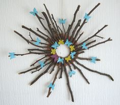 My latest creation of wall art all you need is a cardboard ring, an arrangement of sticks and twigs, hot glue, string and die cuts to decorate Enjoy xx