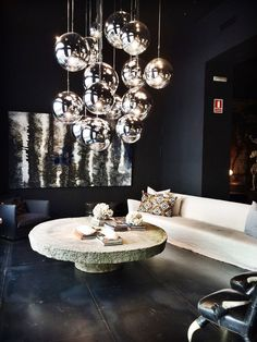 Tom Dixon Bubble Lamps, stone table, washed-linen sofa, iron-tiles floor at Azul Tierra, Barcelona. Fine Furniture, Home Decor Furniture, Furniture Makers, Furniture Design, Luxury Lighting, Home Lighting, Luxury Interior, Home Interior Design, Casa Decor 2016