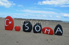 Soma is a town in the district of Manisa Province in the Aegean region of Turkey. Stones composition on stones of the turkish flag with a red heart in memory of the more than 300 victims after the coal mine collapse, 13 May 2014