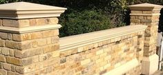 Stock brick wall with coping stones - Forest Drives