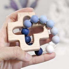 This rosary teething ring is handmade and the recipient was prayed for during its construction by the person that made it. It makes a perfect Baptism gift for a baby boy. The wooden cross is made by a local Catholic artisan. It is cut from durable maple wood, sanded smooth, and finished with a baby safe and food grade mineral oil/beeswax blend. The beads used are FDA approved food grade silicone. Learn more about the bead safety. This item has been third party tested and meets the safety require Catholic Baptism Gifts, Baby Boy Baptism Gifts, The Good Catholic, Catholic Kids, Blue Ombre, Blue Rings, Gifts For Kids, New Baby Products, Baby Safe