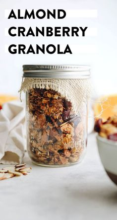 This almond cranberry granola is a healthy, vegan and delicious granola recipe that can be easily stored in mason jars and gifted to friends and family! Edible gifts make the perfect hostess or holiday gift so don't wait to whip up this granola jar recipe. #granolainajar #granola #almondcranberry