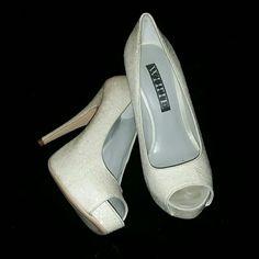 Vera Wang Glitter Heels NIB Glitter Peep Toe Heels by Vera Wang White  Class/Style 3745-0002 Ivory All over glitter heel with peep toe. 4 1/2 inch heel. New in Box. Vera Wang Shoes Heels