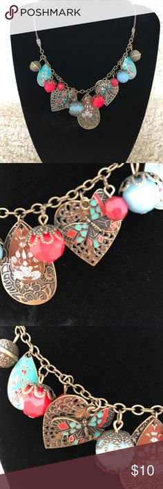 """Coral and turquoise necklace. Chain is metal and leather. Colors are coral and turquoise. Chain is adjustable and measures 19"""" in total length. Great condition. Jewelry Necklaces"""