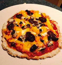 I used organic sprouted spelt flour instead of all purpose. With the water ratio I used about 1/3 c less flour. Yummy crispy crust. I topped it with all organic ingredients of pizza sauce, crushed red pepper, part skim cheese, yellow heirloom tomato, orange  pepper, sun dried  tomato & mushroom.
