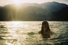 love swimming by mountains