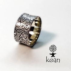 This is a mokume-gane ring, made of sterling silver and traditional japanese alloy shakudo (copper 95%+gold 5%). The ring width is 9,7 mm. Ready for shipping.
