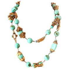 CHANEL VINTAGE COUTURE FILIGREE FITTING TURQUOISE GLASS NECKLACE  France  60's  So rare & stunning, this gorgeous Vintage CHANEL Couture Necklace was created by Robert Goossens and believed to be from the 60's. It's a must have addition to any Chanel lover's collection!