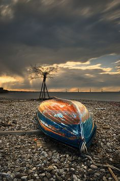 Beautiful old wooden boat, rocks, sunset, sunrise, beach, water, cloudy sky, decay, weathered, beauty, photo