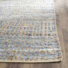 Bring a serene touch to your floors with this hand-woven jute rug, showcasing a variegated design.