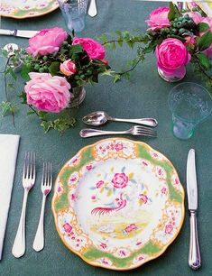 Carolyne Roehm's pink and green antique chinoiserie plates look stunning with roses and ivy in silver julep cups. She purchased these as a young woman with no expendable income, and they survived the fire.This photo is from her book, At Home with Carolyne Roehm.
