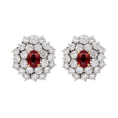 Ruby and diamond two-tiered cluster earclips, centered around two oval-cut rubies weighing approximately total carats set with yellow gold prongs, surrounded by 48 circular-cut diamonds weighing approximately total carats, mounted in platinum. Diamond Studs, Diamond Jewelry, 18k Gold Earrings, Jewellery Earrings, Red Jewelry, Fantasy Jewelry, Necklace Designs, Gold Pendant, Crystal Necklace