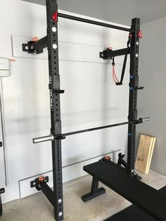 The Rogue Fold Back Wall Mount Rack is Made in the USA and features a Lifetime Warranty, steel uprights, Westside hole spacing, and a unique hinge and pin system. Home Made Gym, Diy Home Gym, Gym Room At Home, Homemade Gym Equipment, Home Gym Equipment, Basement Workout Room, Workout Rooms, Cage Crossfit, Trx Gym