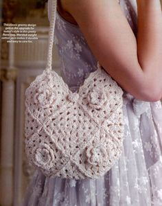 Shabby chic crochet bag with flowers to make it stand out more.  Easy to make and with long shoulder straps.