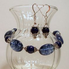 Check out this item in my Etsy shop https://www.etsy.com/listing/87114937/egyptian-blue-lapis-and-blueberry-quartz