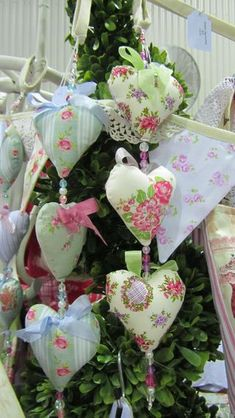 Sweet little fabric hearts hung in a chain with beads for spacers.