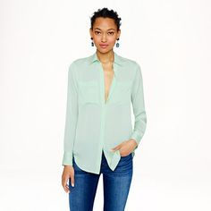 J.Crew - Silk pocket blouse.  Beautiful color for you. Pair them with some destroyed denim and a statement earring and i think its a super cute outfit. You can wear this color a lot with your navy heels!