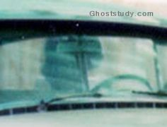 Elvis Presley's mom in her car post mortem.  One of several specters seen on the grounds of Graceland.  See Ghosts and Haunts of Tennessee, Chapter 28:  http://www.blairpub.com/alltitles/ghostshauntstennessee.html