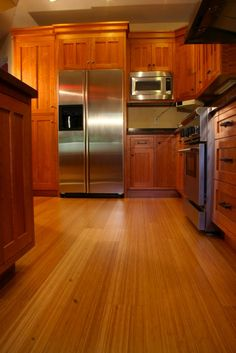 Sustainable kitchen design using bamboo flooring, energy star appliances, low flow fixtures and non-toxic finishes. Inhabiture Design is located in Palo Alto, CA