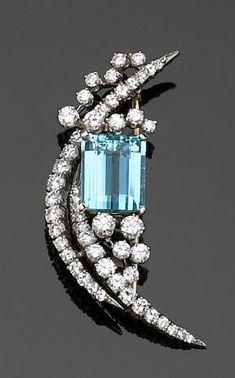 An aquamarine, diamond and platinum brooch, McTeigue