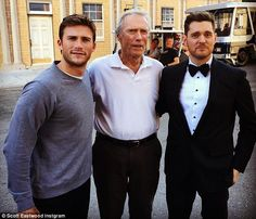 Three good looking guys.  Clinton Eastwood with his son, Scott, and Michael Buble'.  Three prince charmings together.  Wow!
