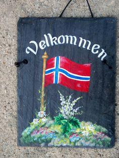 Hanging Hand Painted Norwegian Velkommen Slate Welcome Sign. $49.99, via Etsy.