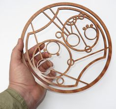Stunning Gallifreyan wood sign with your own name (or words of your choise).  The signs are designed using Circular Gallifreyan created by Loren