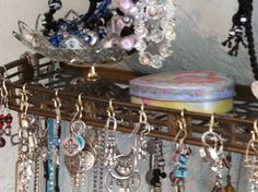 """Jewelry display shelf with """"s"""" hooks.  Found shelf at an antique shop.  Very cheap!"""
