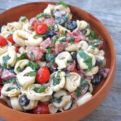 Tortellini Salad - A fresh meal in a bowl! Cheese tortellini, salami, olives, fresh basil and vegetables.