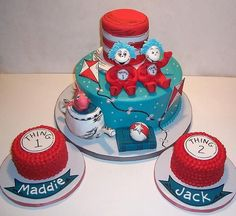 """Cat in the Hat Birthday Cakes - Made this cake and two smash cakes for twins' first birthday. Super cute idea for twins! All the decorations are gum paste, fondant, and/or RKT. The hat is cake covered in fondant. 10"""" round cake with buttercream icing - yeah, it's under there somewhere!"""