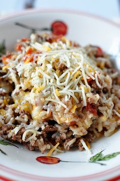 Ingredients1 lb. ground beef 1 pkg. dry onion soup mix 1 1/2 c. hot water 3/4 c. uncooked rice 1 (16 oz) can tomatoes 1 c. shredded cheese 1...
