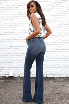 spring / summer - street style - street chic style - summer outfits - casual outfits - black and white multi-stripe sleeveless shirt + medium wash flare jeans