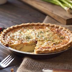 Swiss cheese, bacon, eggs and onions form the rich filling for this classic quiche recipe. Delicious for brunch or lunch. Photo credit: Eva Kosmas from Adventures in Cooking.