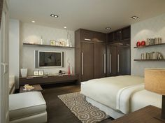 Another view of the large, textured bedroom space with full seating area.