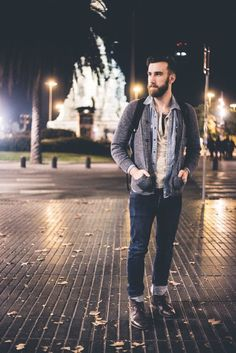 Nail off-duty dressing with this combination of a grey cardigan and deep blue jeans. Dark brown leather casual boots will instantly smarten up even the laziest of looks.   Shop this look on Lookastic: https://lookastic.com/men/looks/cardigan-denim-shirt-henley-shirt/17575   — Light Blue Denim Shirt  — Beige Henley Shirt  — Grey Cardigan  — Black Backpack  — Navy Jeans  — Dark Brown Leather Casual Boots