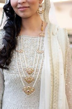 A gorgeous, one-of-a-kind necklace in gold and pearls. Photo by: Noor