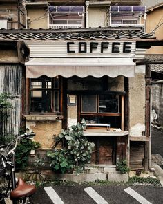 Hidden behind cars, mopeds and bicycles, this tiny little coffeeshop was parked at the end of an equally tiny parking lot in a quiet…
