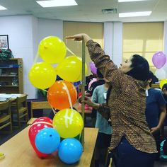 The engineering mission is to build the tallest, freestanding tower using a bag of balloons and masking tape!