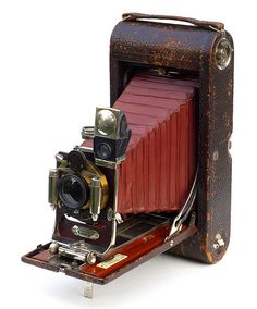 "The 3A FPK is known as a postcard format camera, producing 3 ¼"" x 5 ½"" images on 122 film. Kodak made many variations of the 3A FPK, but this particular example is a Model B. The serial number is stamped onto the front support foot, dating this camera to sometime between September 1903 and February 1904 (later ones have ""KODAK"" on the foot).Features include a leather-covered body made from wood and aluminum, a rotating finder with level, and a Bausch & Lomb lens and shutter."