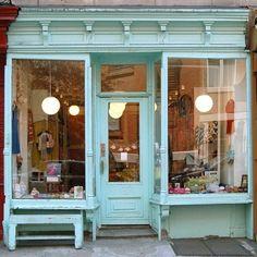 Aqua blue storefront.